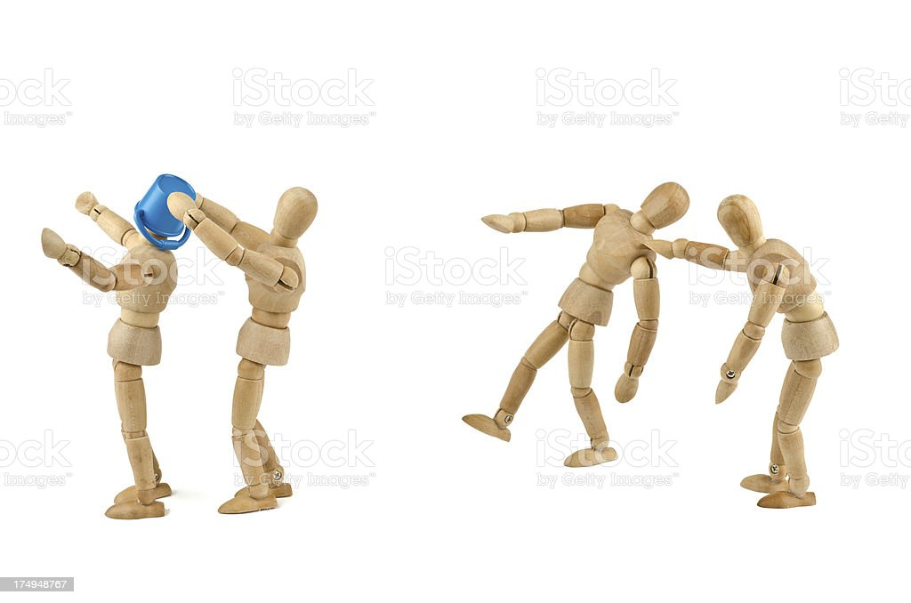 Wooden mannequins bullying another royalty-free stock photo