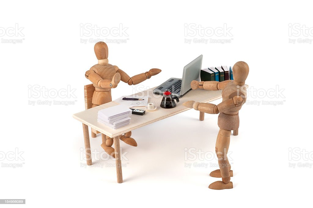 wooden mannequins in discussion with secretary royalty-free stock photo