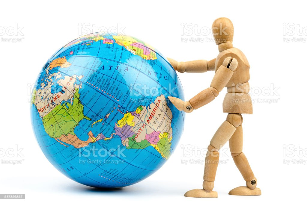 wooden mannequins rolling the world stock photo