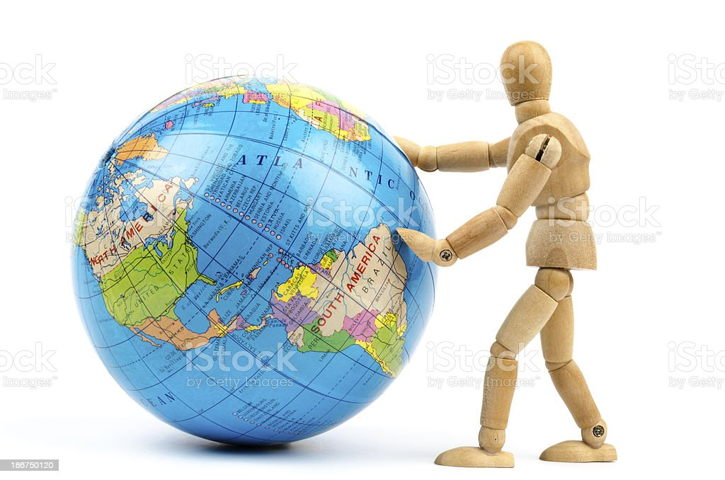wooden mannequins turning the globe world stock photo
