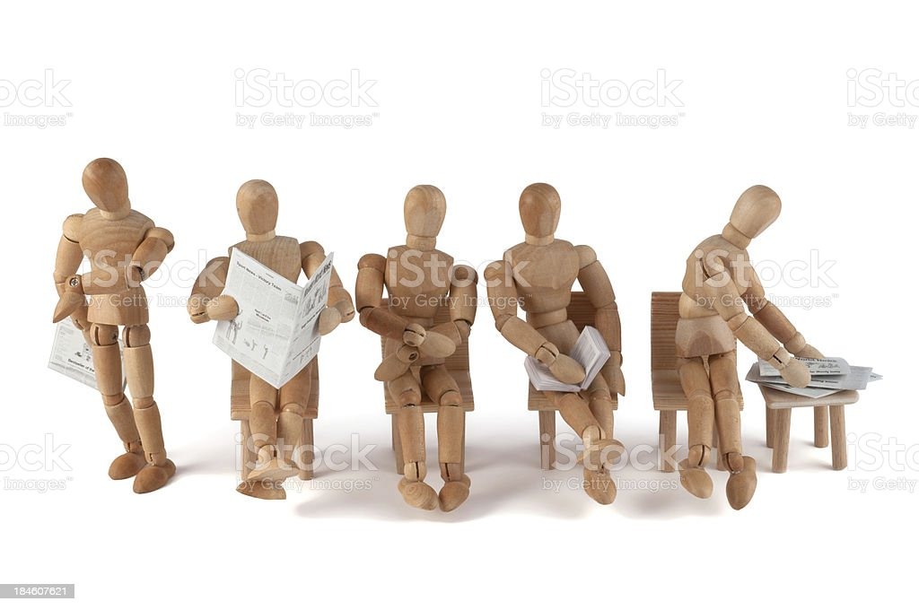 Wooden mannequins waiting... royalty-free stock photo