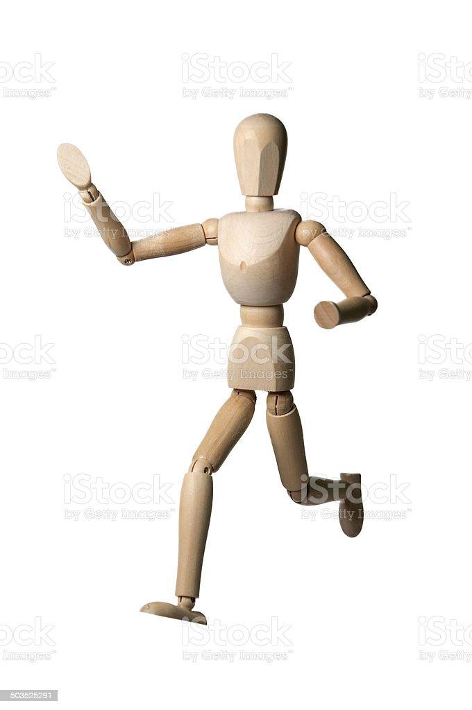 Wooden marionette running stock photo