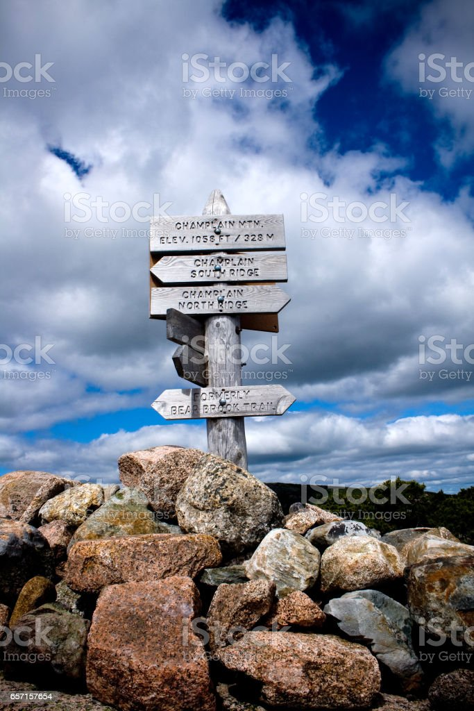 Wooden Marker on Summit of Mount Champlain Hiking Trail in Acadia National Park stock photo