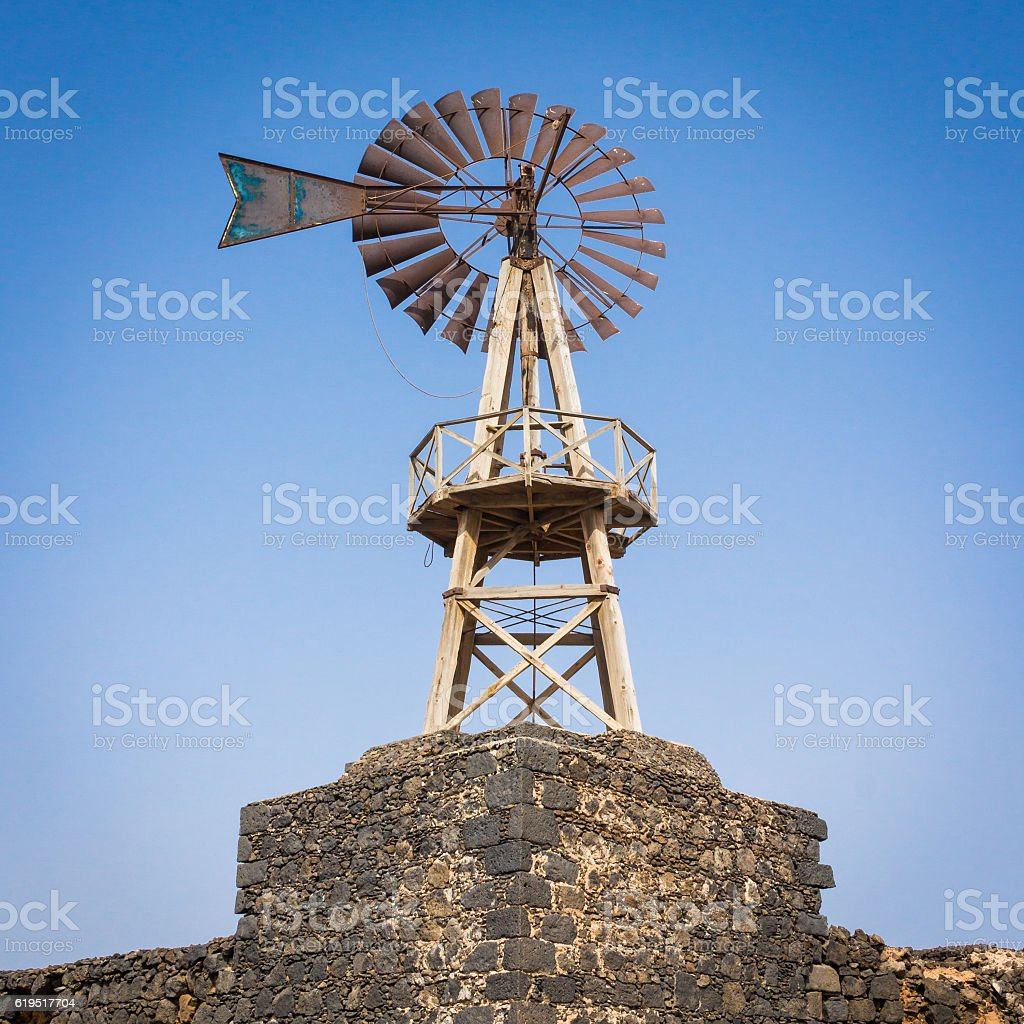 Wooden mill with rusty shovel - body text space stock photo