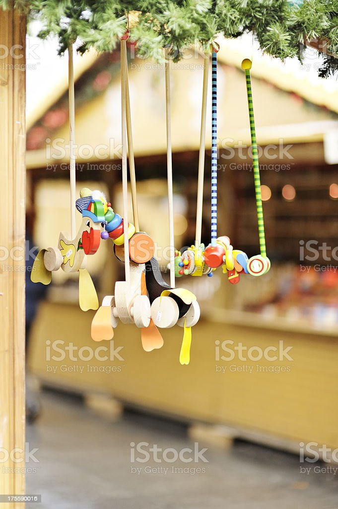 Wooden mobiles on Christmas market stall royalty-free stock photo