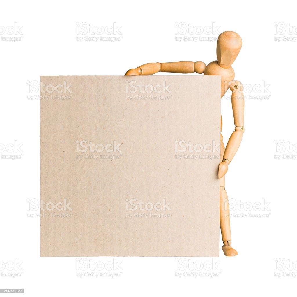 Wooden model dummy holding blank carton board stock photo