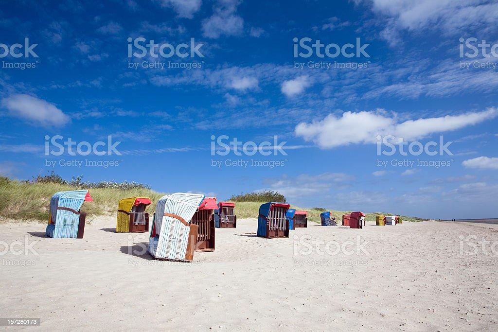 Wooden modules on white sand beach royalty-free stock photo