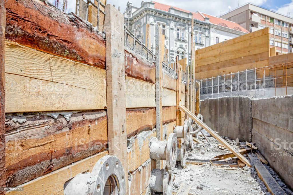 Wooden mold for concrete pouring with pipe system stock photo