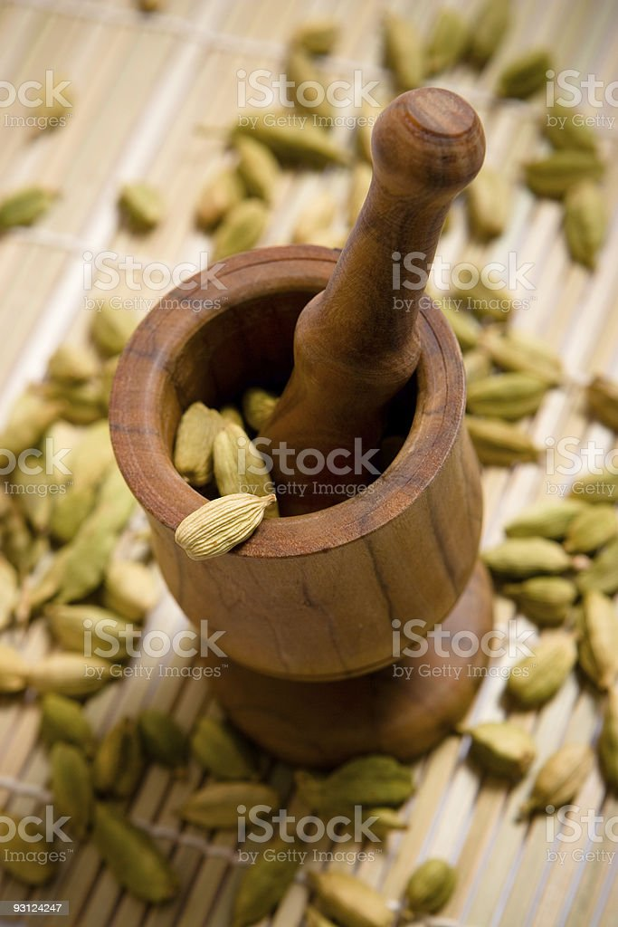 Wooden mortar with cardamom seeds royalty-free stock photo