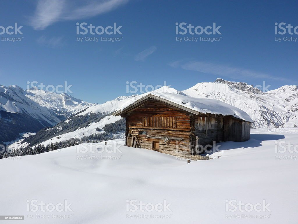 Wooden mountain hut in the Alps royalty-free stock photo