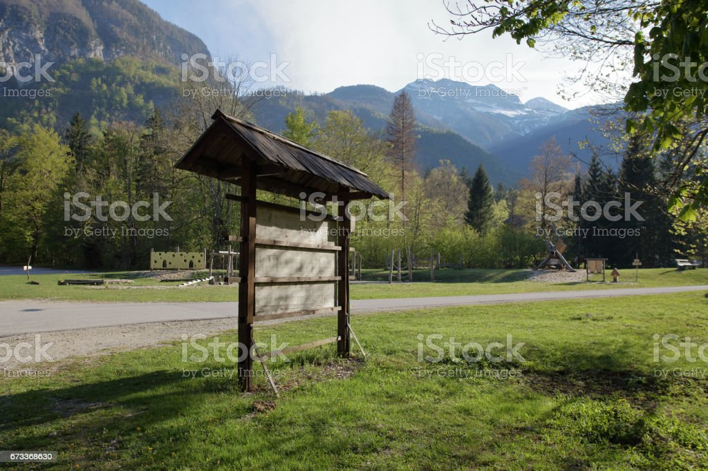 Wooden mountain road sign, vintage board stock photo