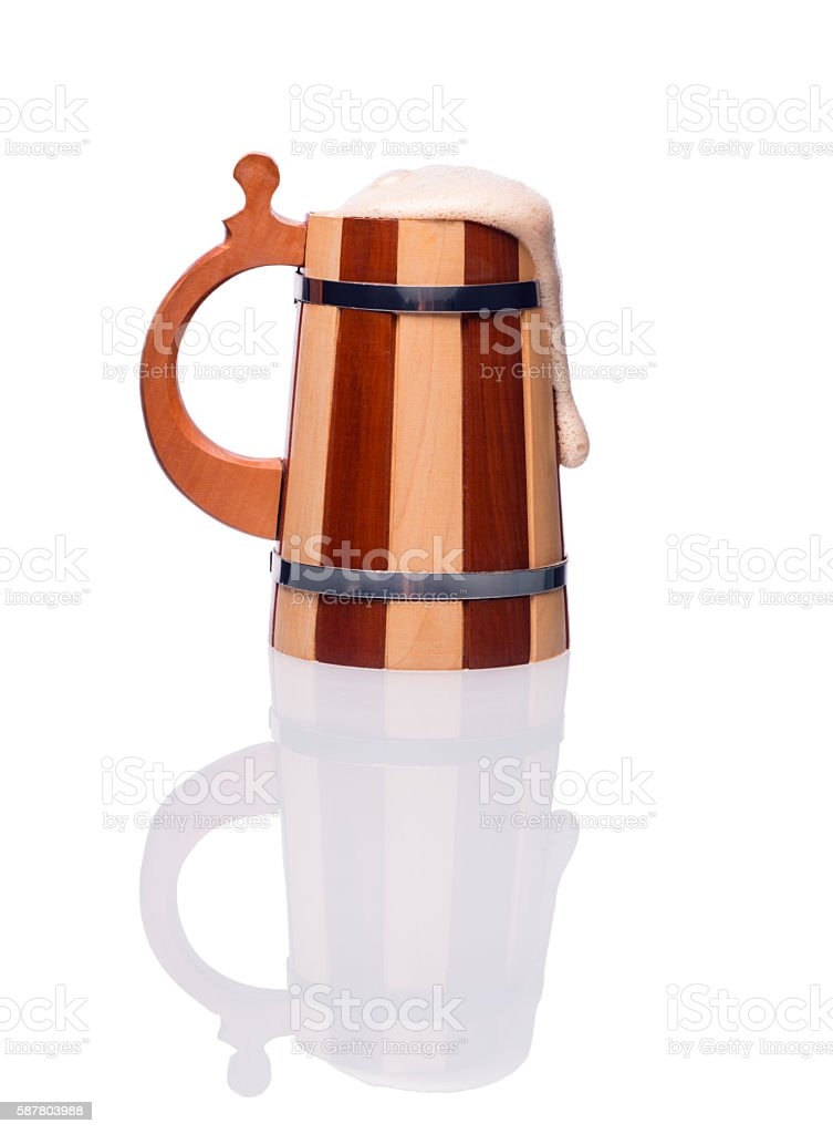 Wooden mug of beer. stock photo