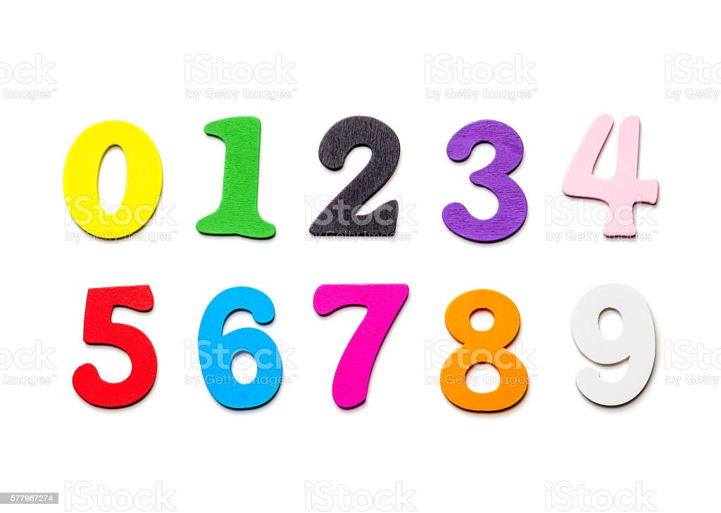 Wooden multicolored numbers close-up, on a white background stock photo