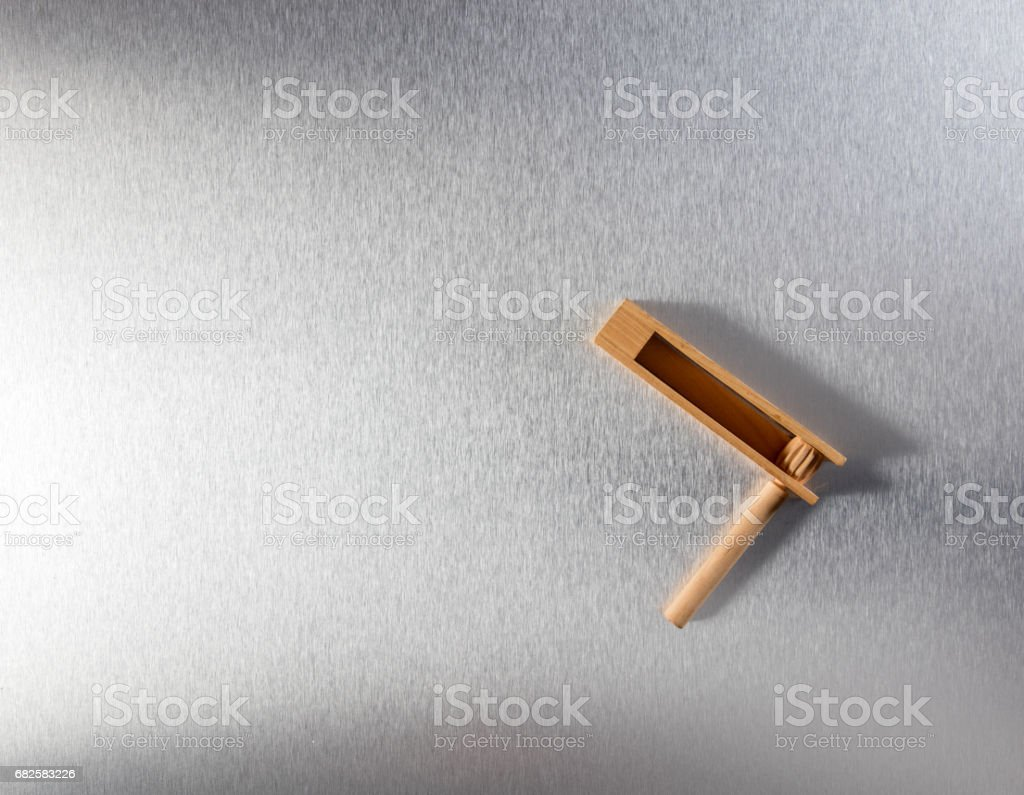 wooden noisemaker or rattle for concept of waking up business stock photo