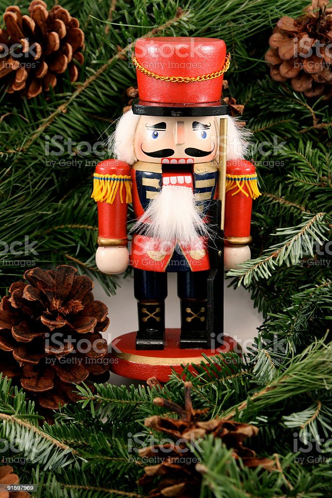 Wooden Nutcracker  On Pine Needles & Cones royalty-free stock photo