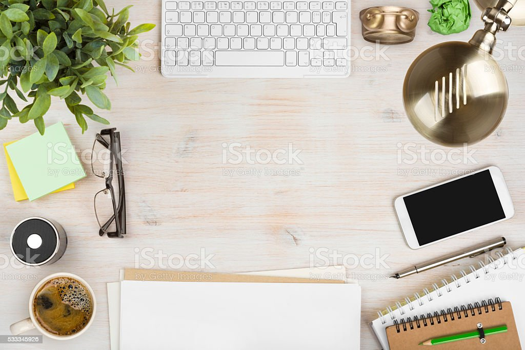 Wooden office desk top view with stationery and computer accessories stock photo