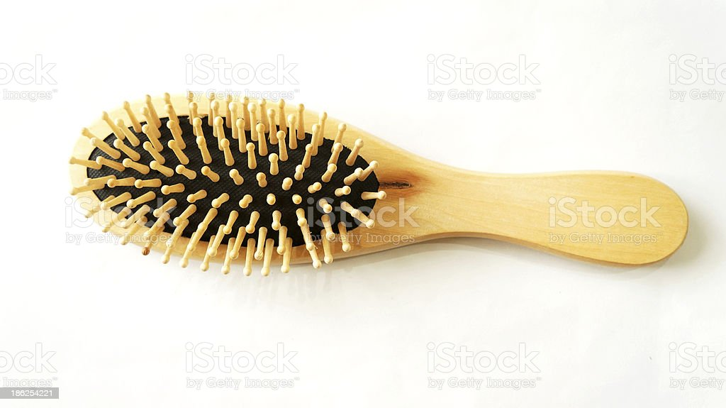 Wooden old comb on white background royalty-free stock photo