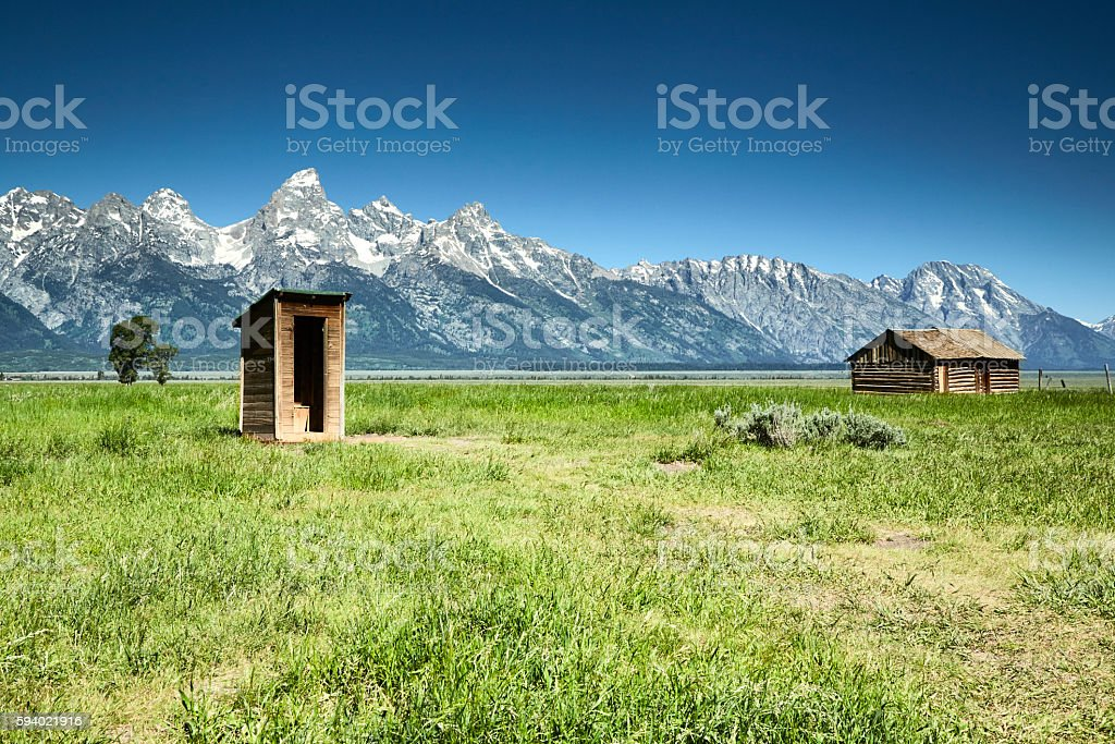 Wooden Outhouse and Barn, Mormon Row, Grand Tetons stock photo