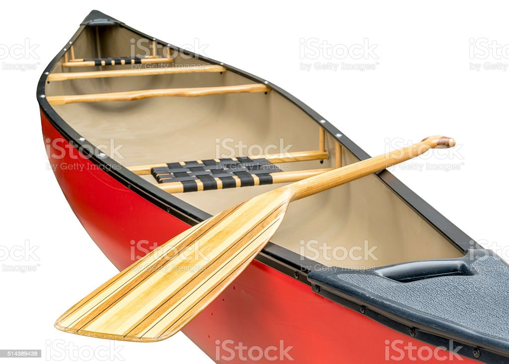 wooden paddle and canoe stock photo