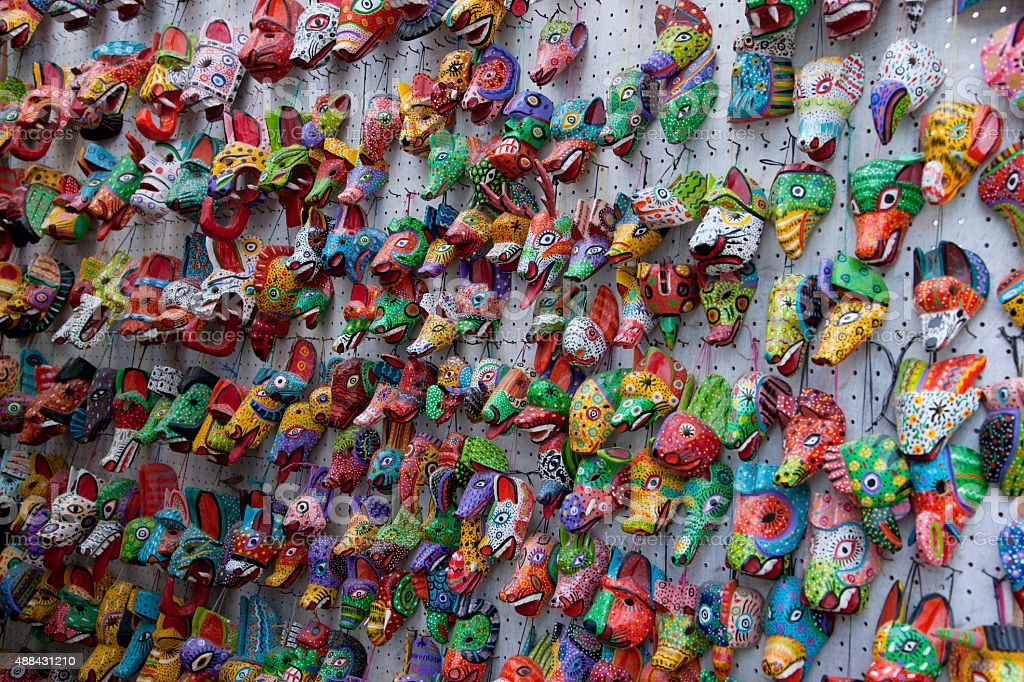 Wooden painted mask souvenirs in Guatemala stock photo
