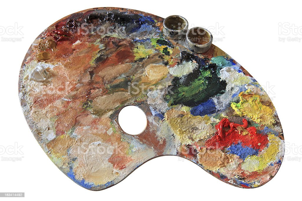 Wooden palette with oil paint isolated on white stock photo