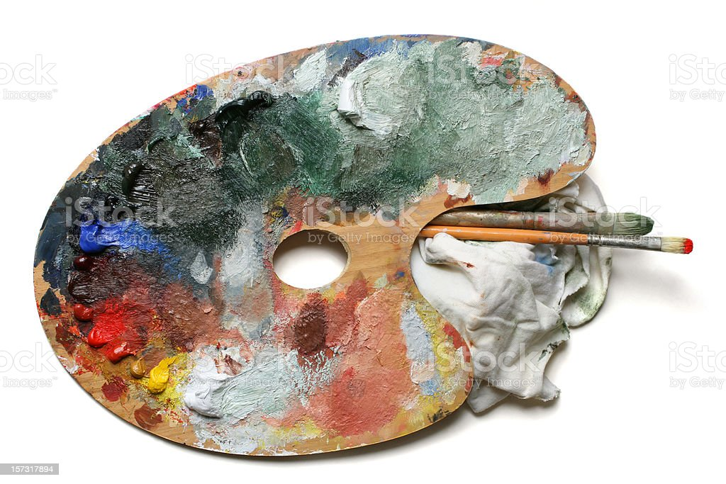 Wooden palette with oil paint on white stock photo