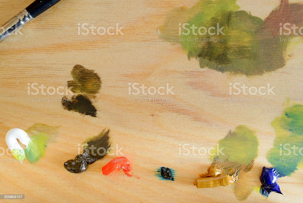 Wooden Palette With Oil-Based Paints stock photo