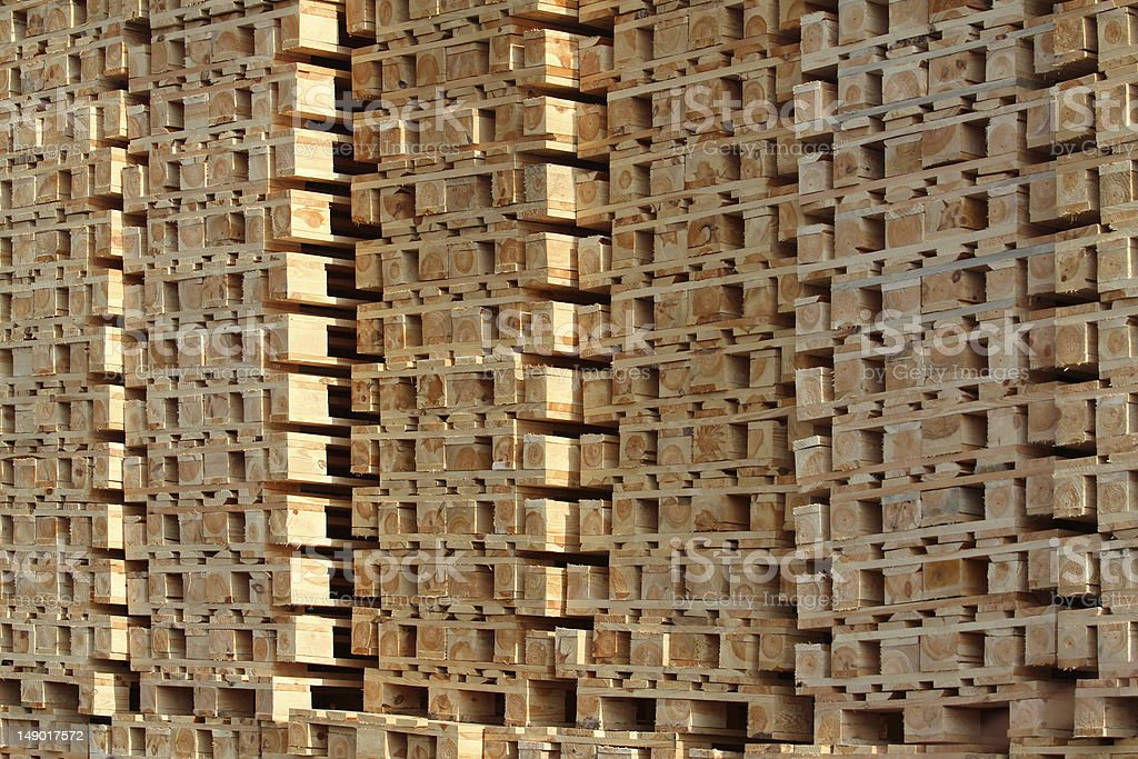 wooden pallet in pile under sun light royalty-free stock photo