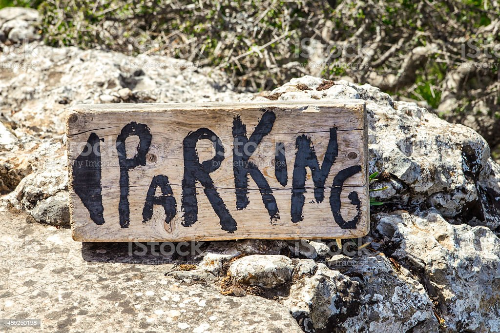 Wooden Parking Sign with directions to Car Parking royalty-free stock photo