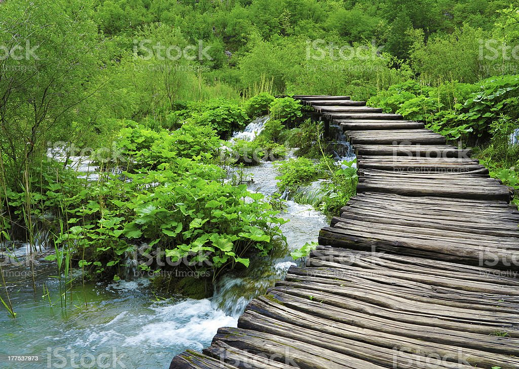Wooden path and waterfall in Plitvice National Park royalty-free stock photo