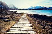 Wooden path leading to Bamberg Beach , Lofoten Islands,Norway