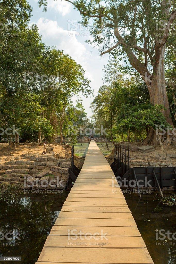 Wooden path to Neak Pean temple near Angkor Wat. Cambodia stock photo