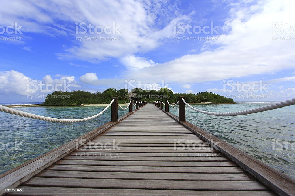 wooden path to sea stock photo