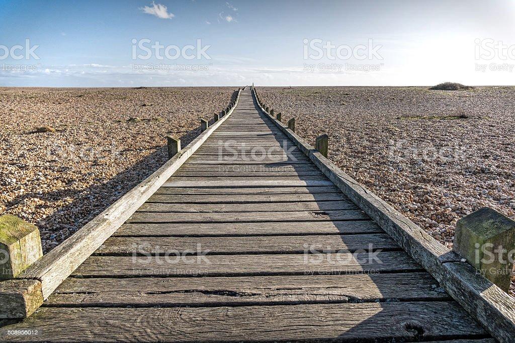 Wooden pathway on the beach stock photo
