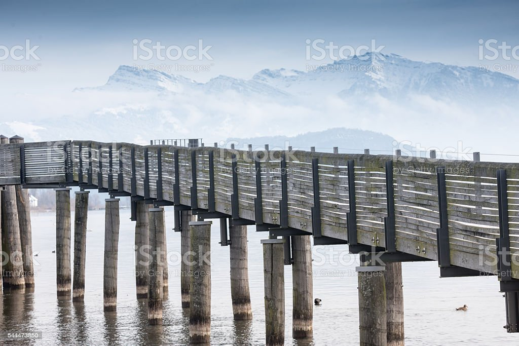 Wooden pedestrial bridge crossing lake Zurich stock photo