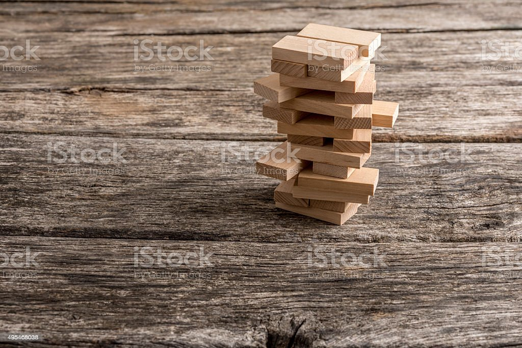 Wooden pegs placed in a tower like structure stock photo