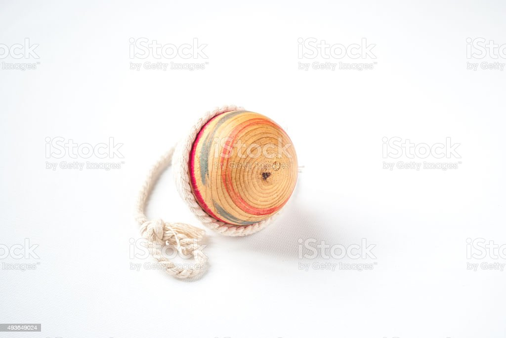 Wooden Pegtop on a White Background stock photo