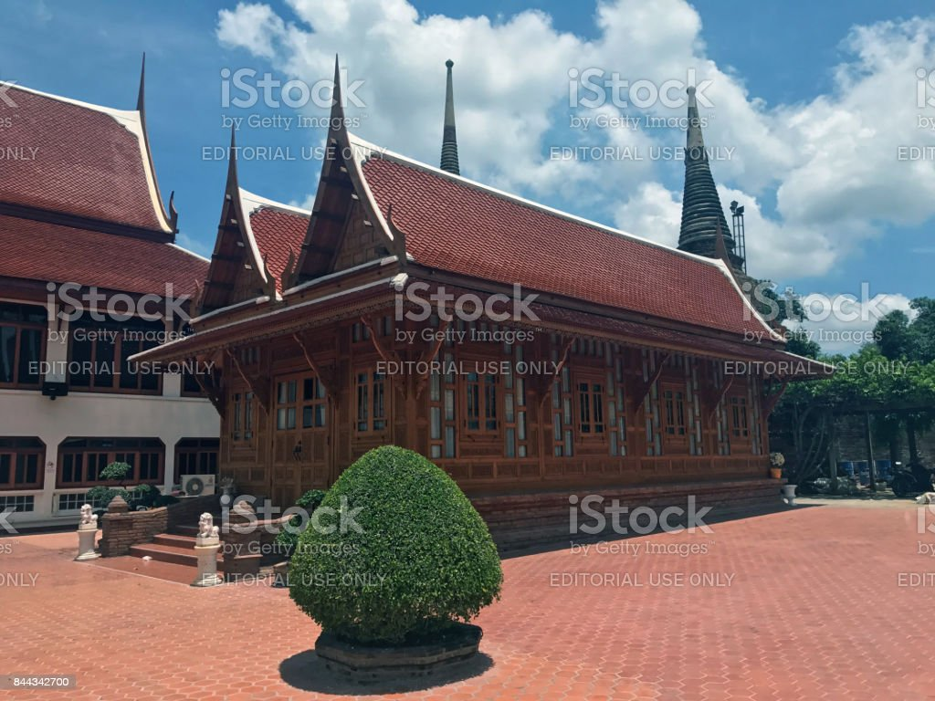 Wooden personage, a house provided for a member of the monk, Thai tradition style at Yai Chaimongkol temple. stock photo