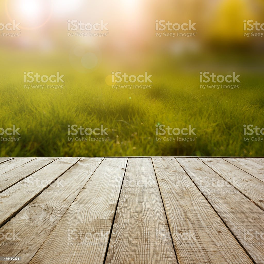 Wooden perspective floor with planks on blurred background stock photo