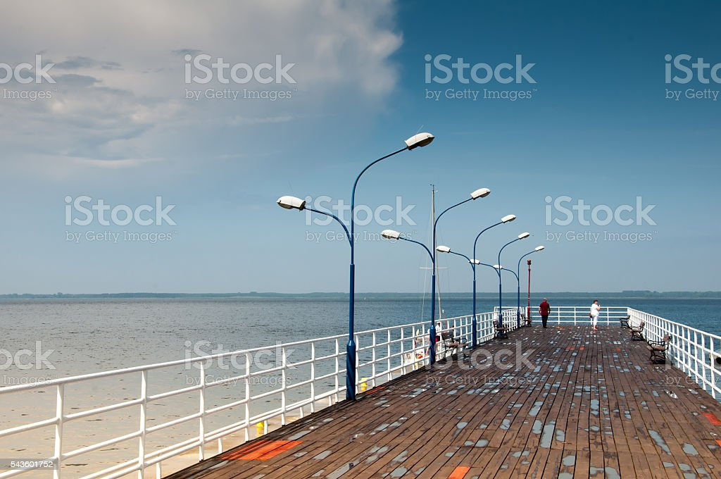 Wooden pier and lanterns on sunny summer day stock photo