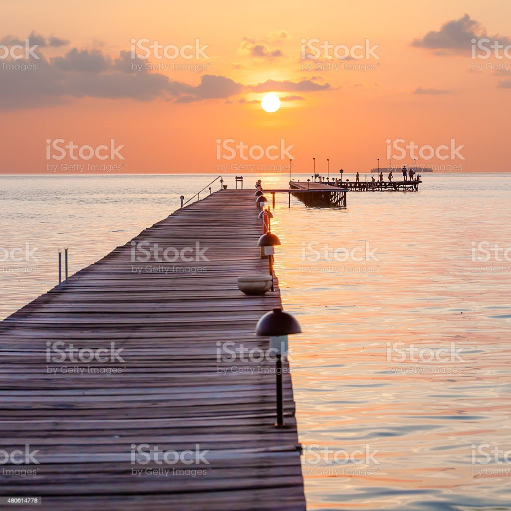 Wooden pier at the island in Indian ocean stock photo