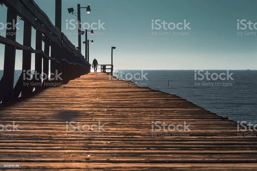 Wooden pier by the sea royalty-free stock photo