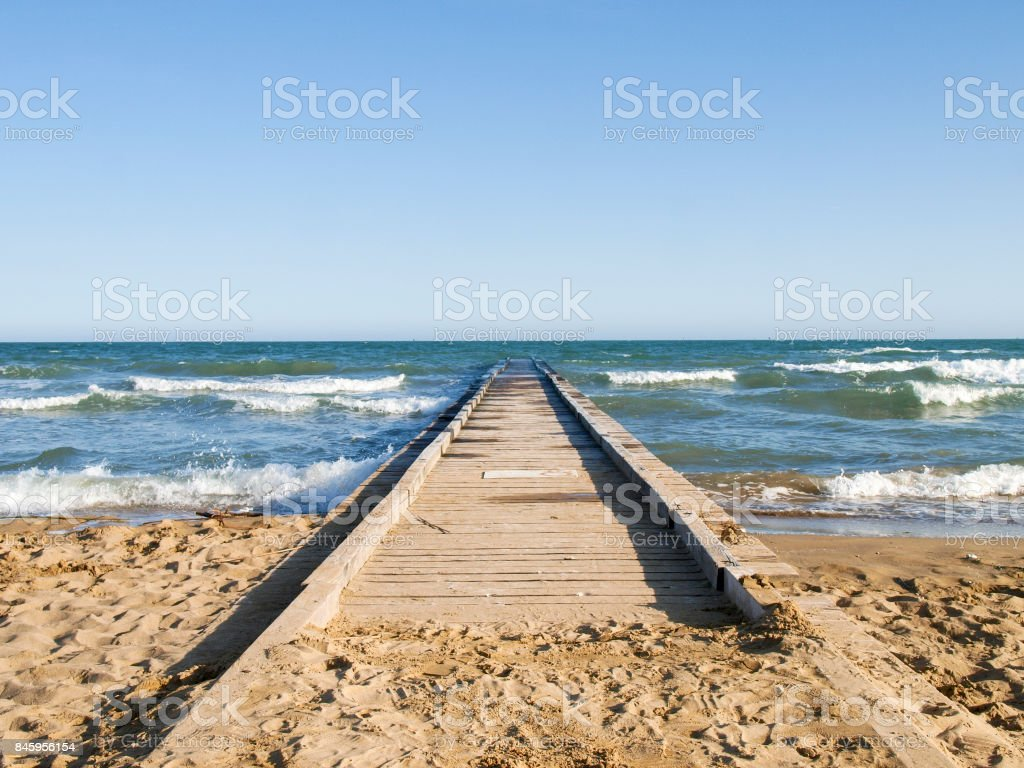 wooden pier for access from the beach stock photo