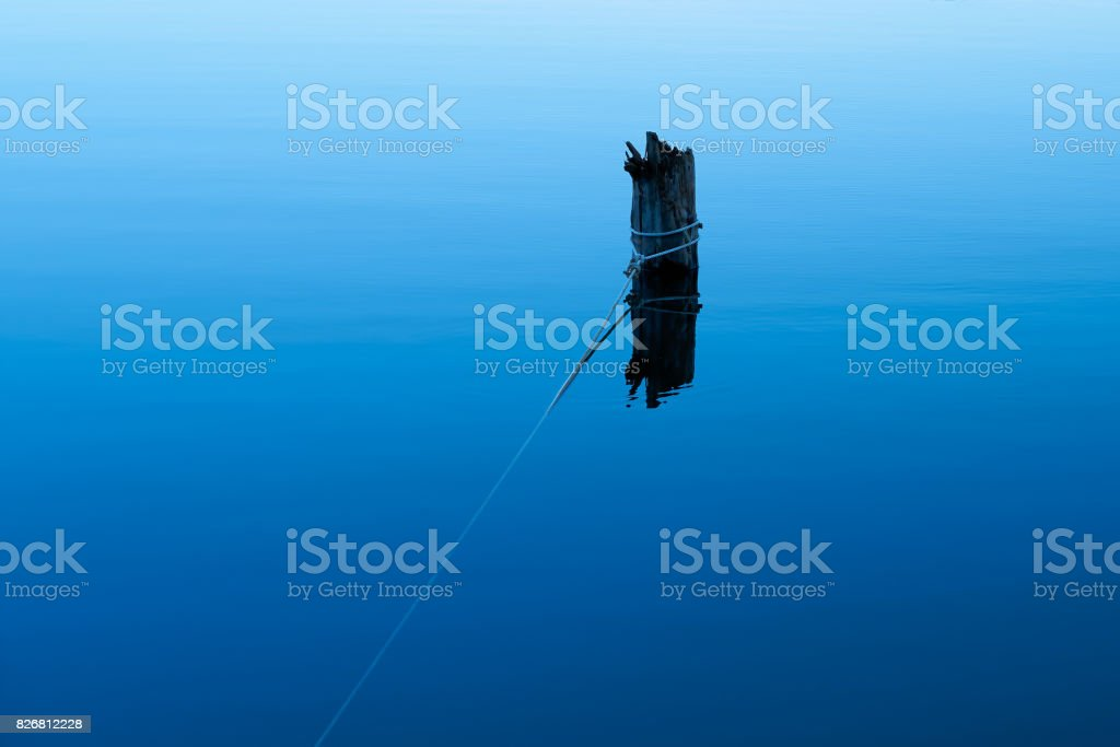 Wooden pier for fixing of boats stock photo