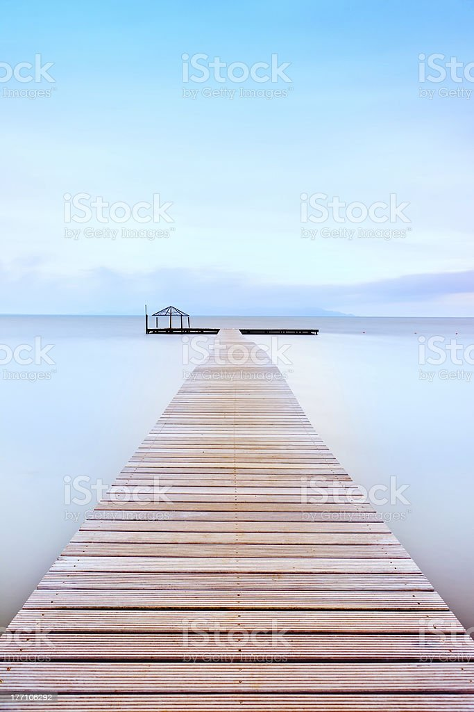 Wooden pier in a cold atmosphere. Tuscan coast. royalty-free stock photo