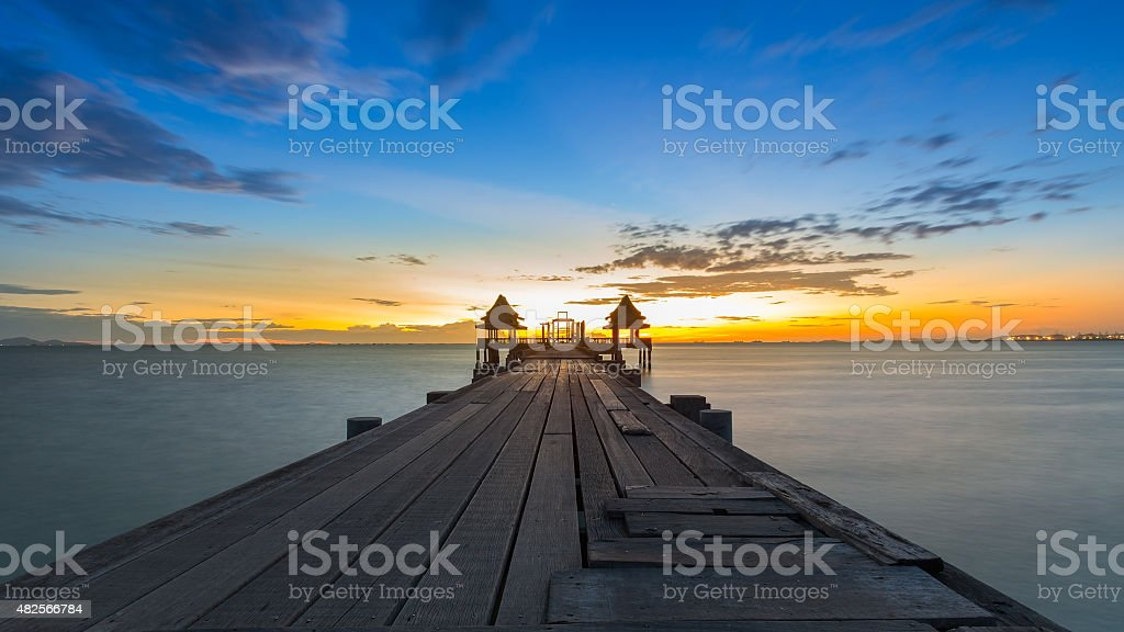 Wooden pier leading out onto the sea stock photo