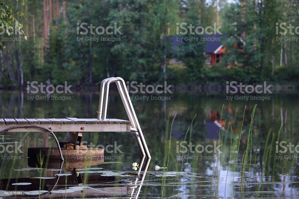 Wooden pier on lake stock photo