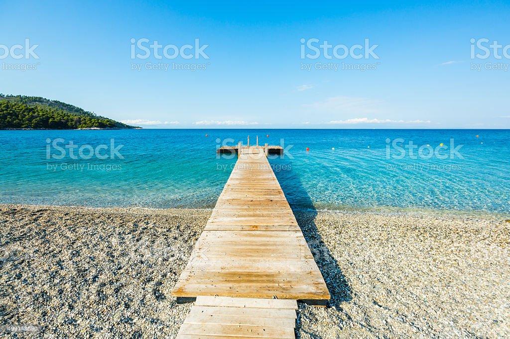 Wooden pier on private beach, Skopelos island stock photo