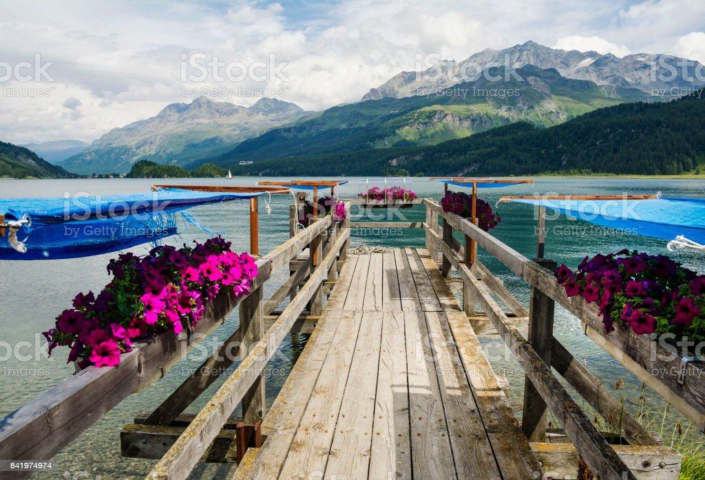 Wooden pier on Sils Lake, Switzerland stock photo