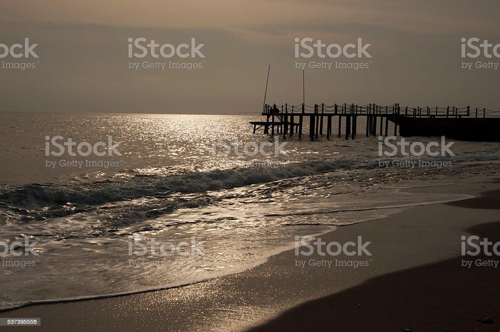 Wooden pier on sunset stock photo